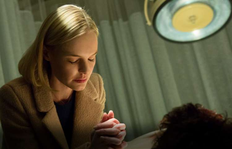 Guideposts: Kate Bosworth, as Eva Piper, prays over her husband in a hospital scene from 90 Minutes in Heaven