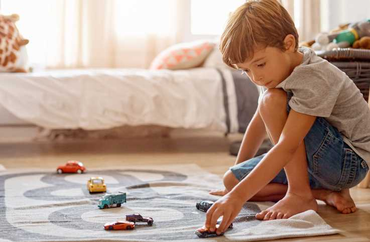 Grandson playing with toy cars.