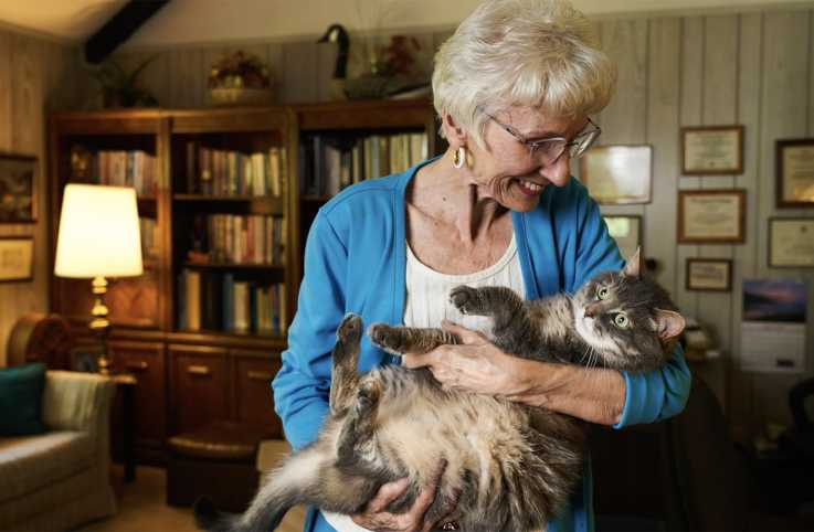 Dr. Carol Bocan cuddles with her cat, Luna