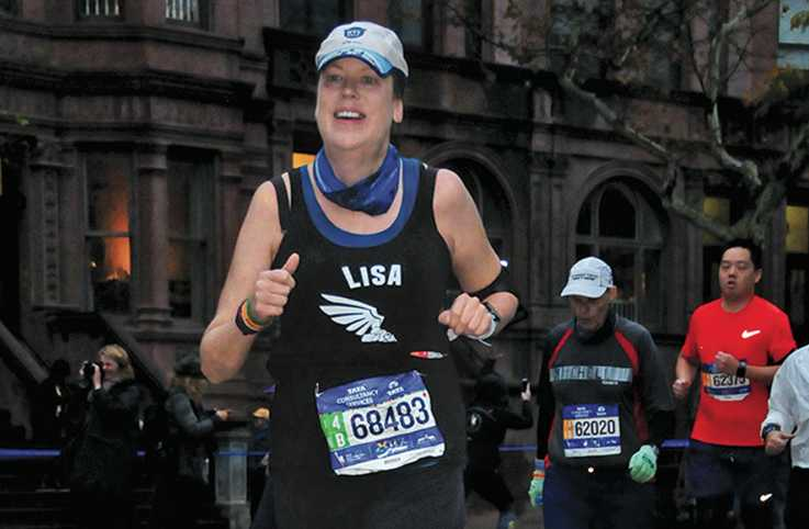 Lisa nears the finish of a marathon