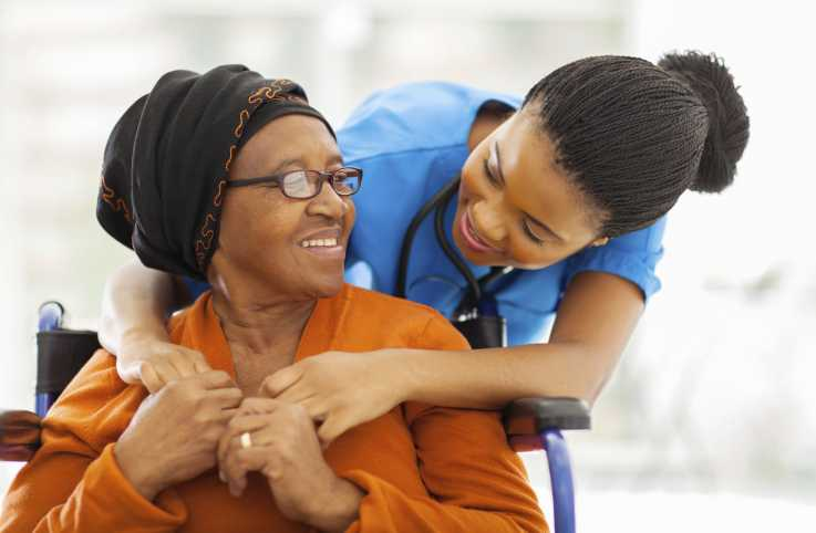 young woman caring for an elderly woman
