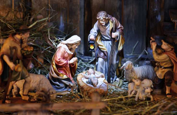 A nativity set with ceramic figure of Mary and Joseph and the infant Jesus