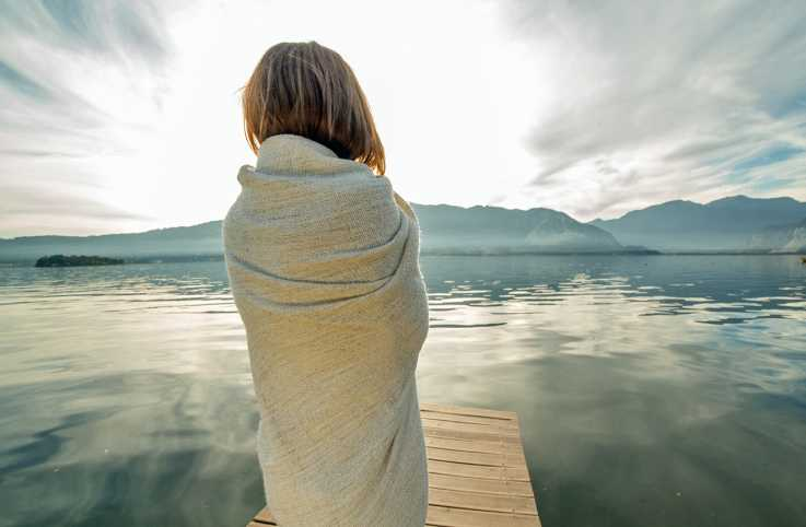 Peaceful woman looking at lake