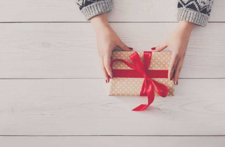 Womans hands holding gift