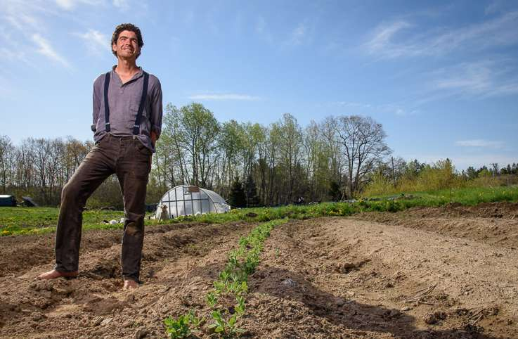 Farmer Michael Hayden stands proudly on the grounds of Folklore Farm in Cherryfield, Maine