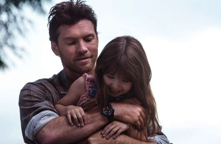 Actor Sam Worthington with actress Amélie Eve, who plays his daughter Missy in The Shack