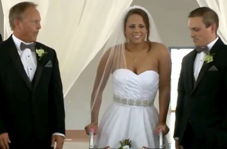 Stevie Beale begins her inspiring march down the aisle.