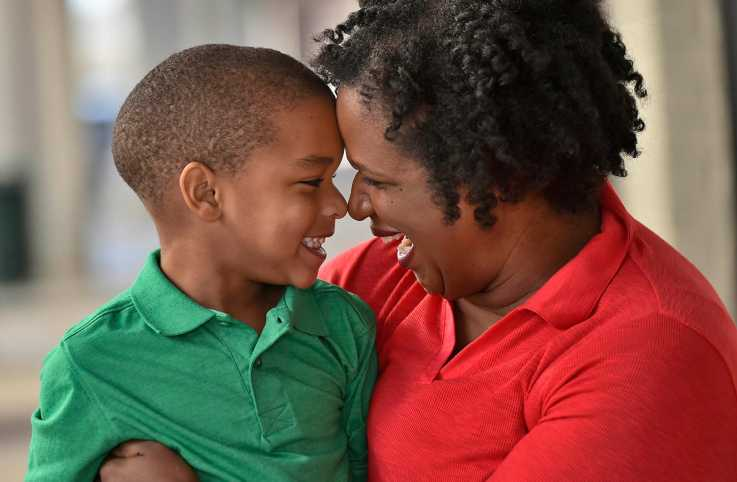 Danita shares a tender moment with son Caleb