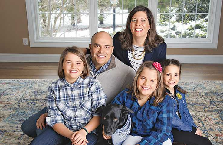 """""""Our readers can help us all love more and hate less,"""" says John Temple, here with his family."""
