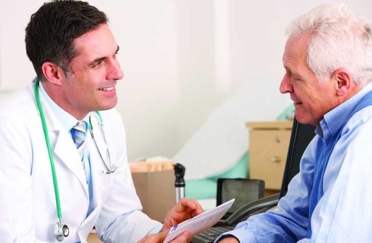 A doctor giving some tips to a senior man.