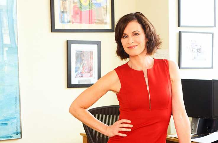 "Elizabeth, ABC ""20/20"" news anchor and cover star of the October 2016 Guideposts, in her office"