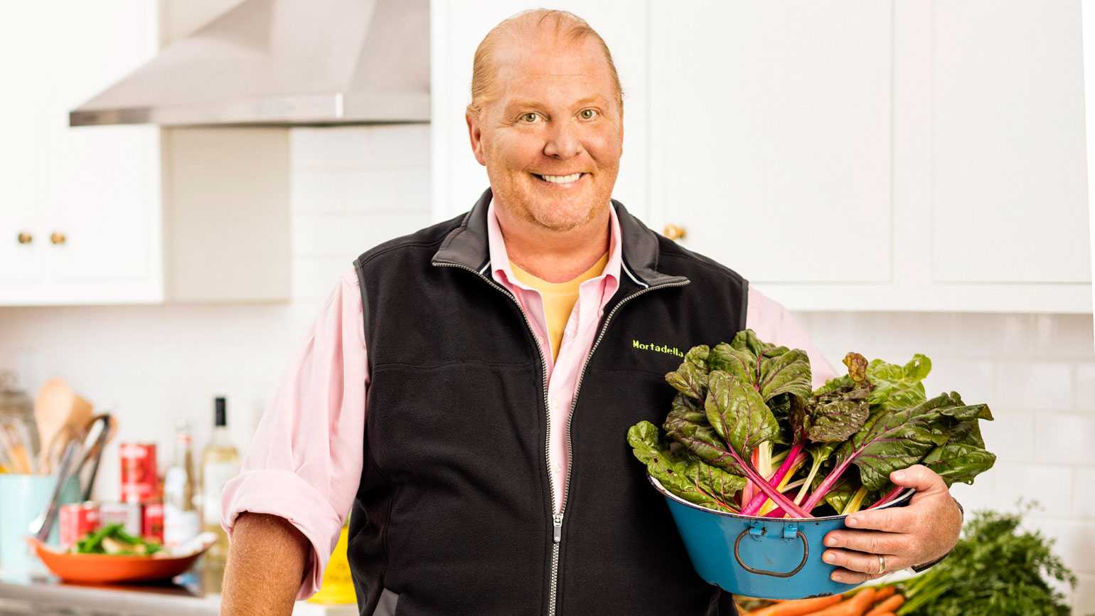 Celebrity chef Mario Batali poses with some of the ingredients that will go into his Thanksgiving dinner
