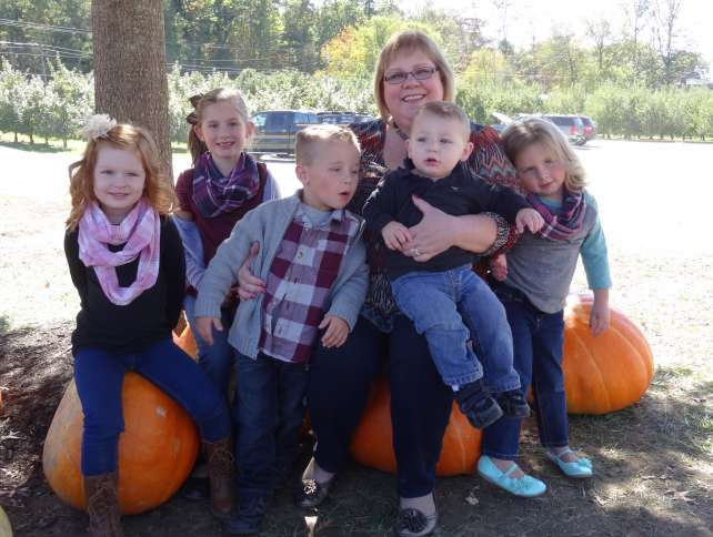 Happy grandmother Michelle Cox recently visited an apple orchard with her grandkids.