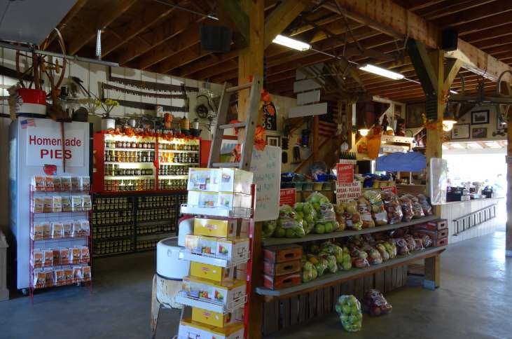 The store at the apple orchard was fully stocked not only with apples but pies, peelers, jams and jellies.