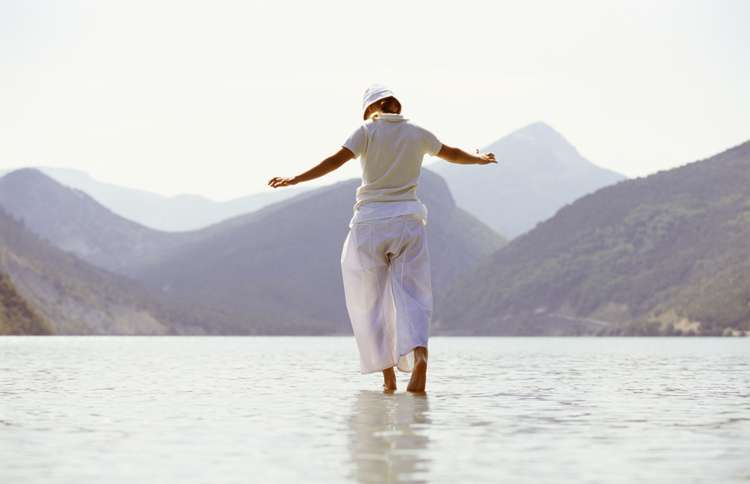 a woman walks on water inspired by 2 Timothy 1:7
