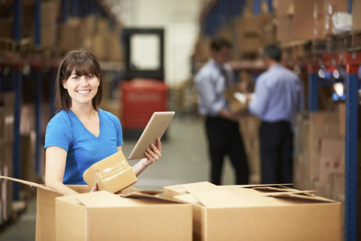 Warehouse worker with note pad. Thinkstock.