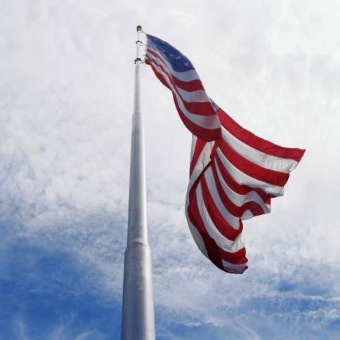 American flag flies on Memorial Day at half staff