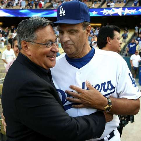 Jaime embraces former Dodgers manager Joe Torre