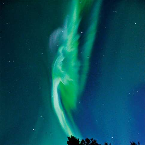 Guideposts: An angel's form appears in the northern lights over Saskatchewan, Canada