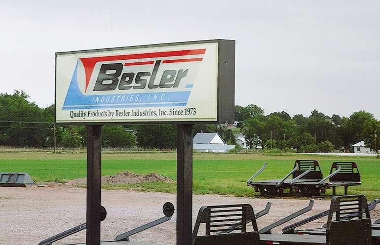 A large sign advertising a business called Besler Industries. Besler was Max's last name.