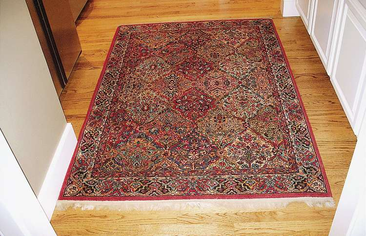 The antique Persian rug that Janis moved into the home she would share with her new husband, Jim Durham