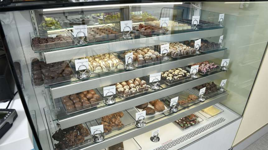 The display counter at the Chocolate Spectrum boasts a wide array of baked goods and chocolate treats