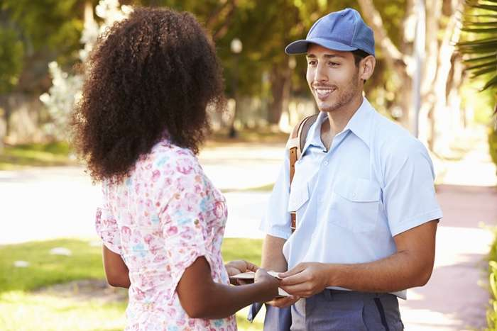 Woman thanking her mailman for Be an Angel Day