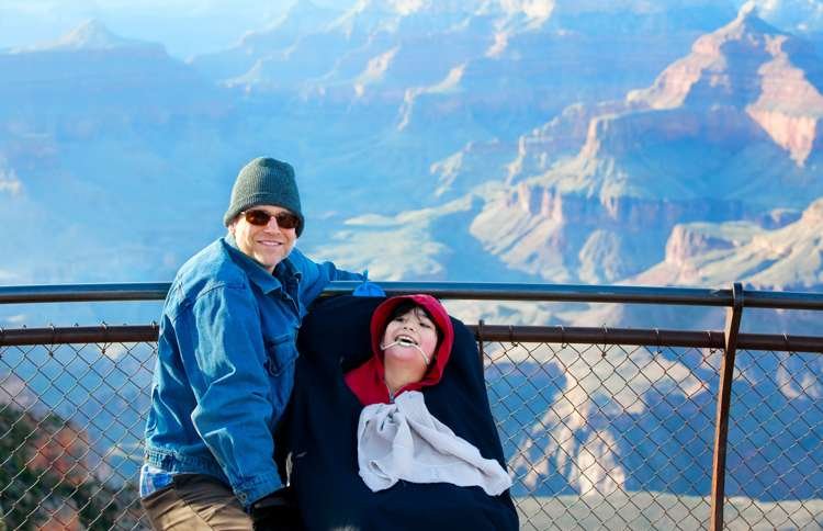 A father brings his severely disabled son to the Grand Canyon, expressing  Matthew 25:40