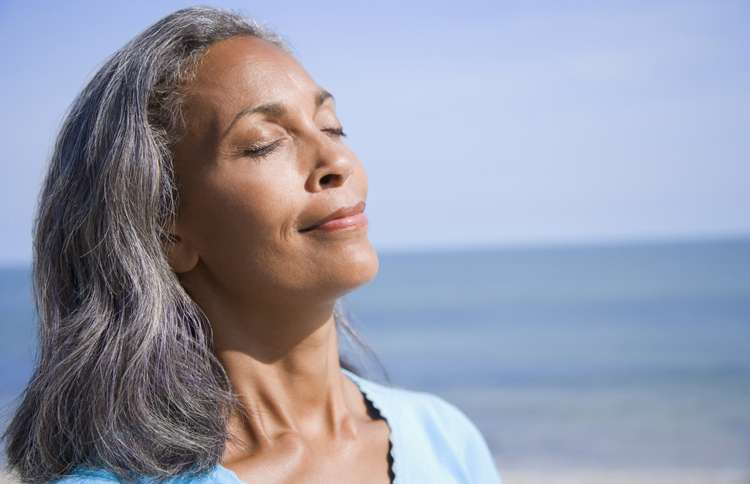 A peaceful woman releases anxiety, thanks to Matthew 6:34