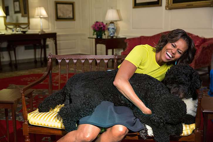Guideposts: Michelle Obama hugs Bo and Sunny in the White House