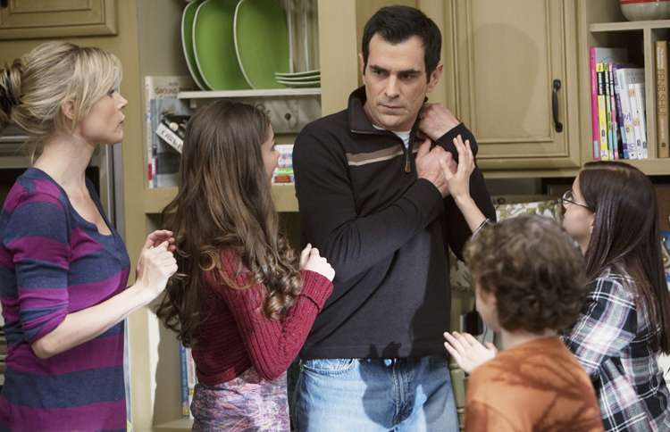 Ty Burrell (center) as Phil Dunphy on Modern Family