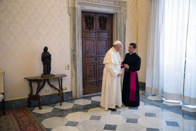 Pope Francis confers with his interpreter follwong a private audience with President Barack Obama in the Vatican