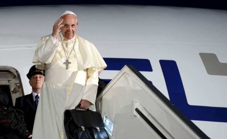 Pope Francis bids farewell as he boards his El Al jetliner for the flight to Rome
