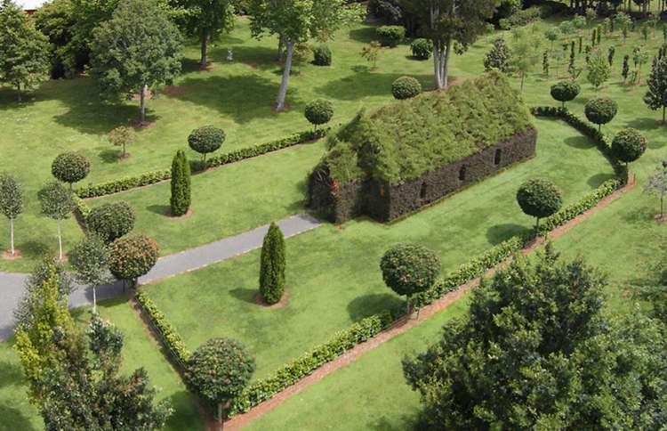 """Guideposts: In 2011, landscaper Barry Cox started work on this """"living church"""" in his backyard. His fairytale-like creation sits on three acres of gardens, seats 100 and is even available for weddings."""