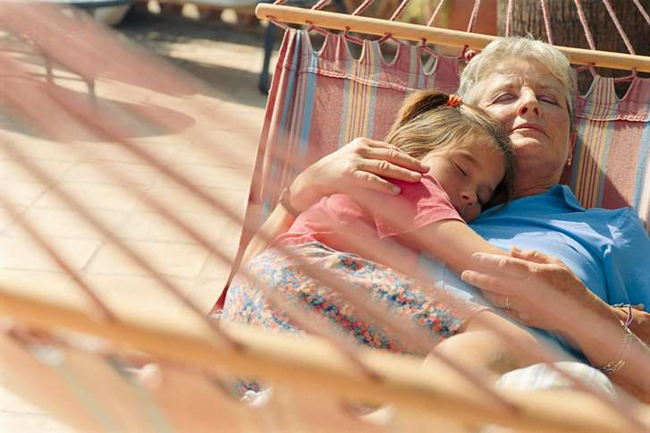 Guideposts: A grandmother holds her granddaughter close in a hammock
