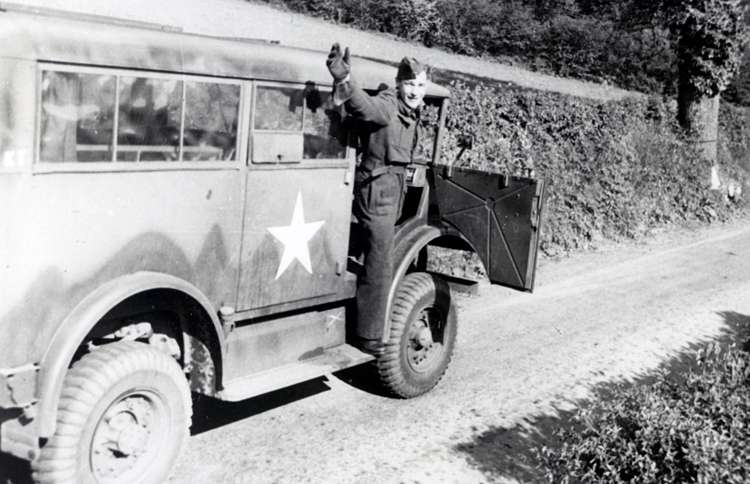 Guideposts: George Emmerson waves from the passenger seat of his army truck
