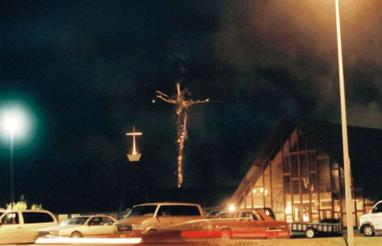A pair of crosses in a Norfolk, Nebraska, fireworks show