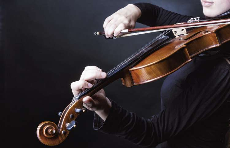 Guideposts: A close-up of a young woman playing violin