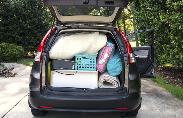 Guideposts: An open hatchback reveals a car packed with a college student's possessions