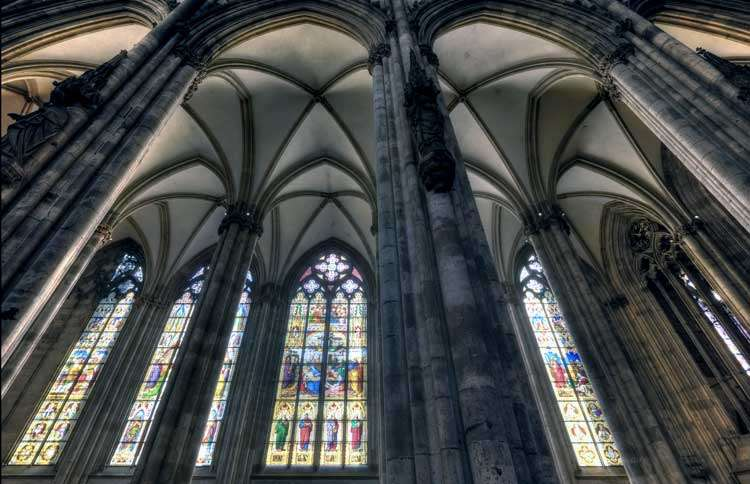 Guideposts: Soaring arches over the Cologne Cathedral's towering windows of stained glass