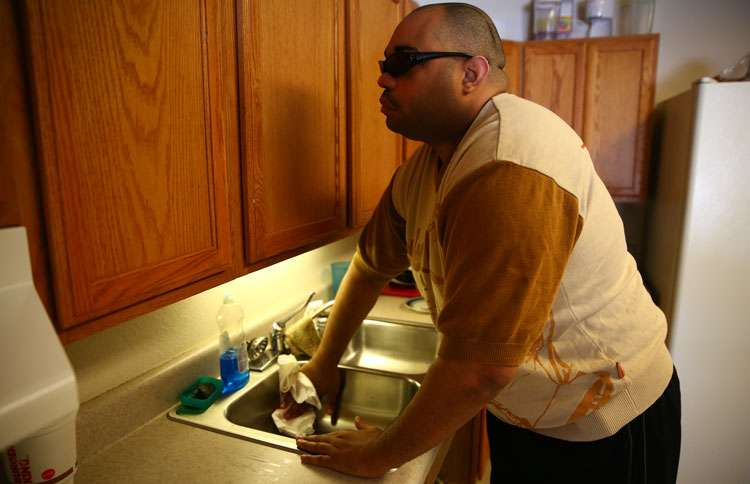 Guideposts: Willie cleans the kitchen after dinner.