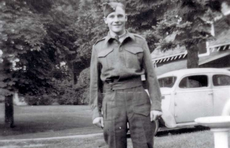 Guideposts: A young George poses in his army uniform.