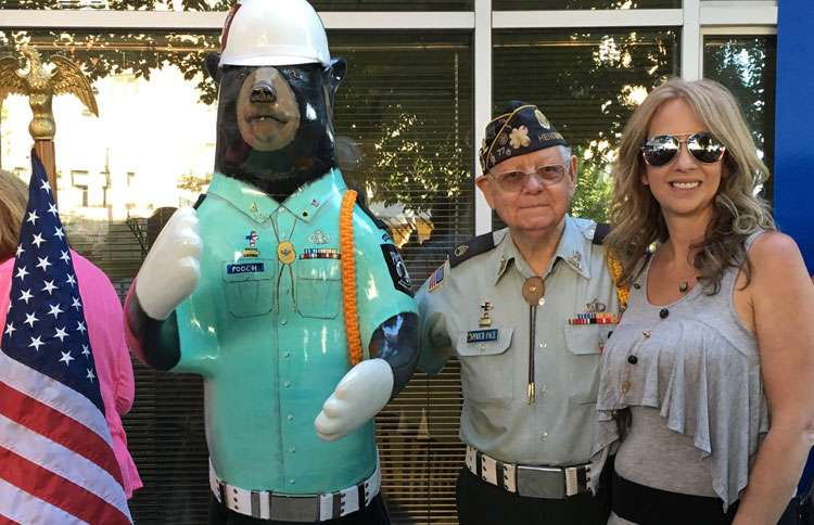 Andrea poses with local veteran Rufus 'Pooch' Pace and Pooch the Bear