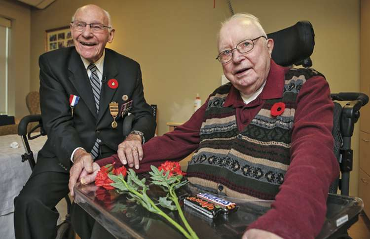 Guideposts: Henk (right) settled in Canada after the war, always hoping he'd meet George again.