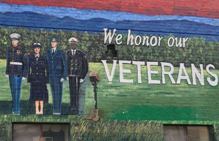A mural honoring veterans that Andrea painted for the people of Hendersonville