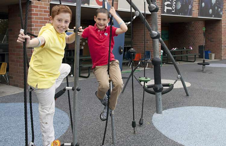 Guideposts: Dylan (right) and Jonah hang out on the playground at their school.