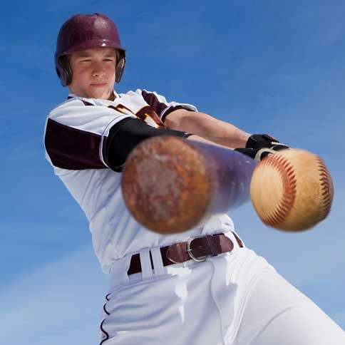 Guideposts: A batter takes a mighty swing at a pitched baseball.