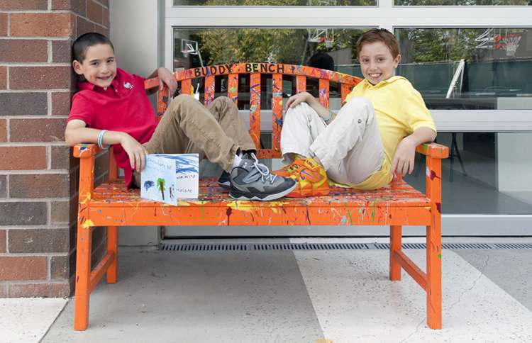 Guideposts: Jonah and Dylan relax on the Buddy Bench at school.