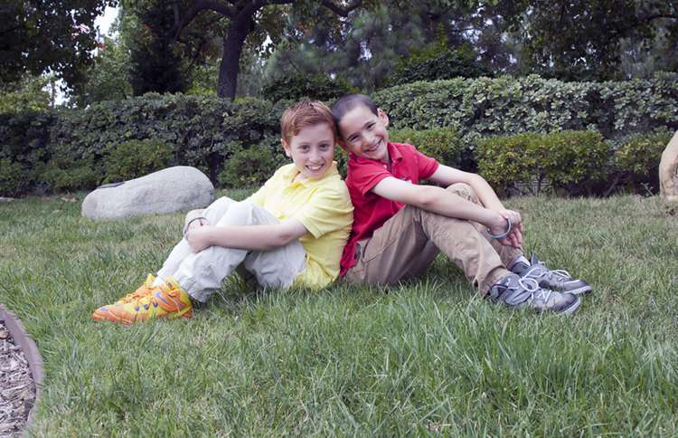 Guideposts: Jonah and Dylan relax in a park.