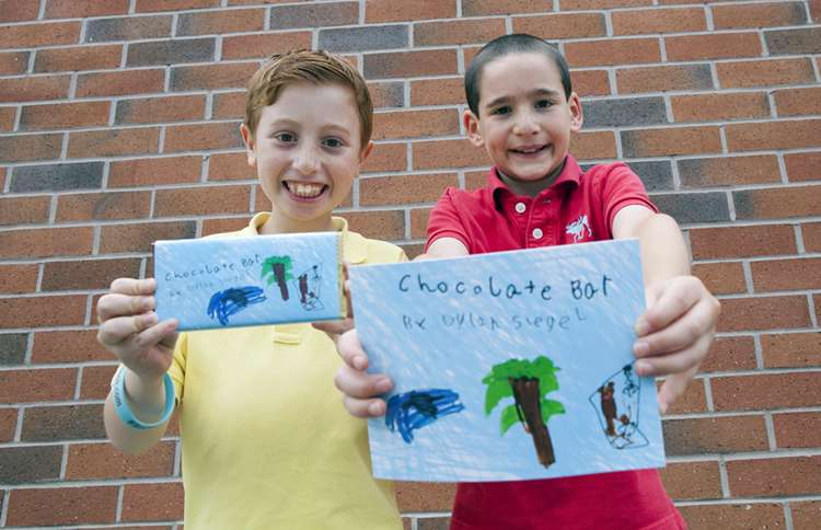 """Guideposts: Jonah and Dylan proudly display their copies of """"Chocolate Bar."""""""